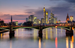 Frankfurt skyline at dusk in HDR. Frankfurt skyline at dusk with Ignatz Bubis bridge, Frankfurt - HDR version - Hessen, Germany Royalty Free Stock Images