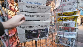 Frankfurter Allgemeine Zeitung Magazine about Donald Trump new USA president. PARIS, FRANCE - NOV 10, 2016: Man buying German newspaper Frankfurter Allgemeine stock video footage