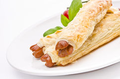 Frankfurter and puff pastry Stock Photos