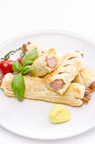 Frankfurter and puff pastry Stock Images