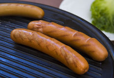 Frankfurter sausage. On a grill Stock Photos