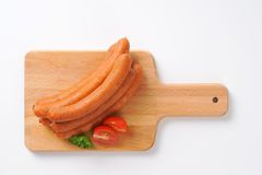 Frankfurter sausages. Raw frankfurter sausages on wooden cutting board Stock Photo