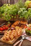 Frankfurters свернули сосиски испеченные в печенье слойки Стоковые Фотографии RF