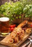 Frankfurters свернули сосиски испеченные в печенье слойки Стоковые Фото