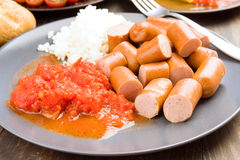Frankfurters chopped, cooked with rice and tomato Stock Photo