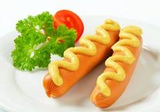 Frankfurters with mustard Stock Photos