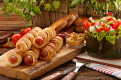Frankfurters rolled sausages baked in puff pastry Stock Photo