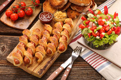Frankfurters rolled sausages baked in puff pastry Royalty Free Stock Image