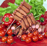 Frankfurters with vegetables. Royalty Free Stock Photo