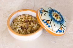 Frankincense. In incense-box on sandstone background Stock Images
