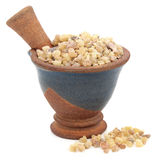 Frankincense. In a mortar with pestle over white background Royalty Free Stock Photography