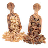 Frankincense and Myrrh. In olive wood scoops over white background Royalty Free Stock Photo