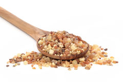 Frankincense and Myrrh. In an olive wood spoon over white background Royalty Free Stock Photo