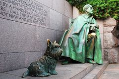 Franklin Roosevelt Memorial, Washington. The Franklin Delano Roosevelt memorial in Washington DC has the President sitting, presumably, in a wheel chair with his Royalty Free Stock Photo