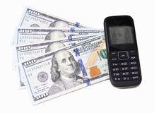 Franklin on dollar bills and in display of mobile telephone Stock Photo