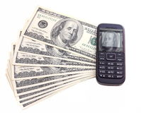 Franklin on dollar bills and in display of mobile telephone Stock Photography