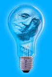 Franklin face and light bulb stock photo
