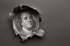 Franklin in hole of paper Royalty Free Stock Image