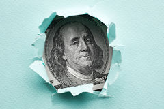 Franklin in the hole of paper Royalty Free Stock Photo