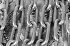Franklin looks. Through the links of metal chain Royalty Free Stock Photo