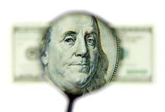 Franklin portrait through the magnifier Stock Photos