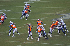 Franklin protects manning. Peytons last line end defense behind Franklin stock photos