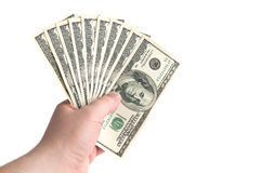 Franklin's ten. Hand holding thousand US dollars white  isolated Stock Photography