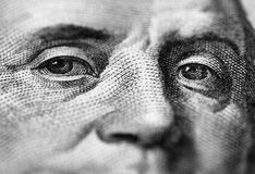 Franklin stare. Close up of Benjamin Franklin stare on one hundred dollars banknote royalty free stock photography