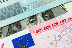 Franklin stare. Between euro banknotes. Close-up of One Hundred Dollar Bill and European Union Euro Note Stock Photo