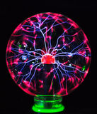 Franklinism ball. In a sealed glass ball, by weak electrostatic produce franklinism, inert gas is the ball inside the light, the formation of such a landscape Stock Image