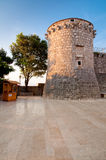 Frankopan fortress tower marble pavement and little wooden shop Stock Photography