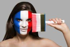 Frankreich-Flagge gemalt auf dem Gesicht stockfoto