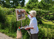 Frankrike/Giverny: Konstnär på arbete i Rue Claude Monet Royaltyfri Fotografi