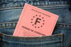 Frans rijbewijs in de achterzak jeans, rijbewijsconcept royalty-vrije stock afbeeldingen