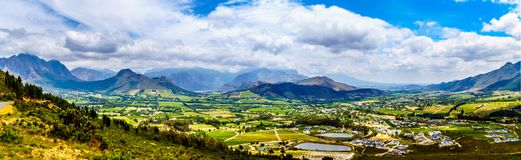 Franschhoek Valley in the Western Cape province of South Africa with its many vineyards that are part of the Cape Winelands. Panorama View of the Franschhoek stock image