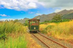 Franschhoek Wine Tram. Hop-on hop-off tour, one of the best ways to discover Franschhoek Valley in scenic landscape of Wine Region, near Cape Town, South Africa royalty free stock images