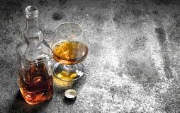 Franse cognac in glas royalty-vrije stock afbeeldingen