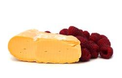 Franse kaas en framboos Stock Afbeeldingen