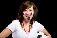 Franse teamverdediger met fluitje en bal stock foto's