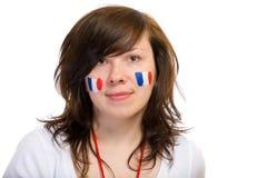 Franse teamverdediger met vlaggen op haar wangen stock foto