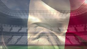 Franse vlag die voor gevulde arena golven stock footage