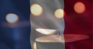 Franse vlag met kaars het uitgaan stock footage