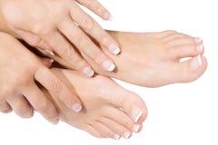 Fransk manicure och pedicure Arkivfoto