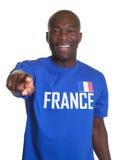 Fransk sportfan som pekar på kameran Arkivfoto