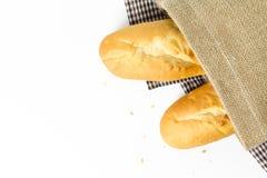 Franska bagetter i säck på vit bakgrund Royaltyfria Bilder