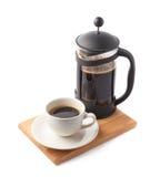 Franskapresskruka och kopp kaffe Arkivbilder