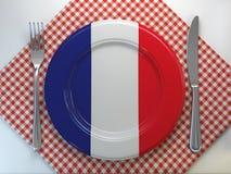 Franskt estaurant begrepp för kokkonst eller för rfrench Platta med flaggan av Frankrike med kniven och gaffeln stock illustrationer