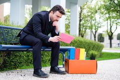 Desperate businessman after being fired at work Royalty Free Stock Photos