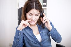 Frantic businesswoman making a phone call stock photography