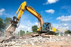 Frantoio idraulico a demolizione del sito Fotografia Stock